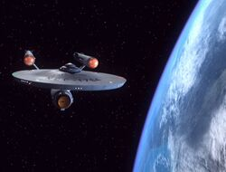 Defiant-NCC1764overEarth