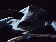 USS Voyager docked at DS9