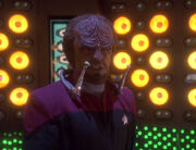 Worf wearing virtual control device