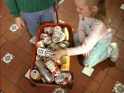 Girl-recycles-cans