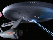 USS Enterprise firing phasers downward, remastered