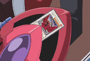 Black Rose Dragon in back of Duel Disk