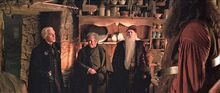 Hagrid&#39;s hut with visitors Malfoy Fudge Dumbledore