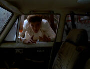 Janeway looks through Lada window