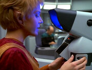 Kes identifies the macrocosm using Sickbay microscopes
