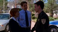 Billy Miles with Fox Mulder and Dana Scully in 2000