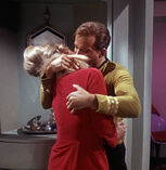 James Kirk forcefully grabs Janice Rand