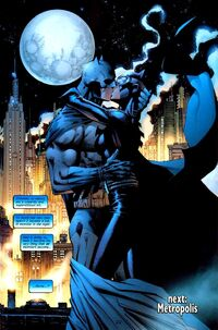 Batman and Catwoman kiss in front of the Gotham skyline