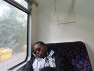 Man sleeping on bus train