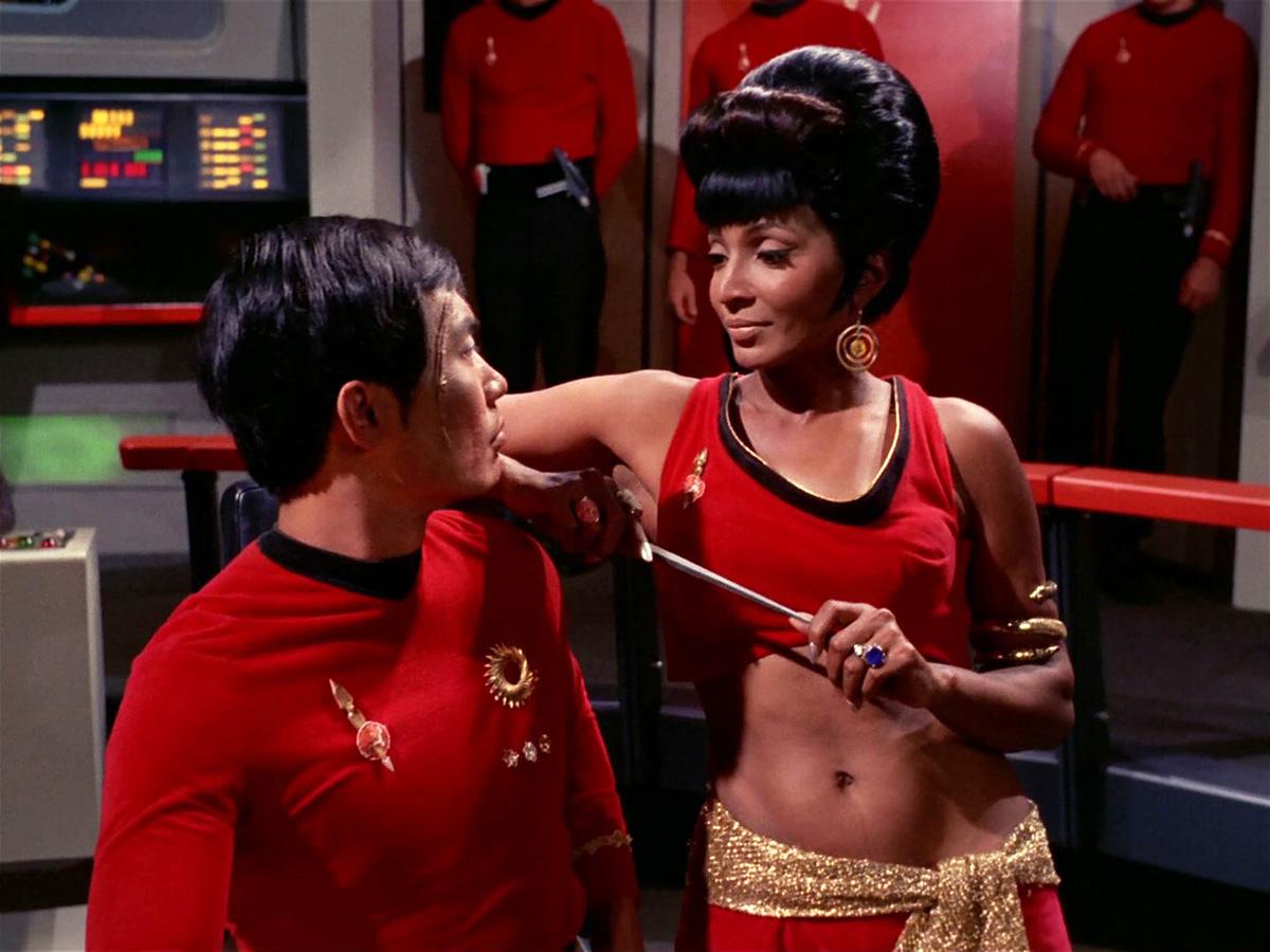 [Image: Uhura_distracts_Hikaru_Sulu_(mirror).jpg]