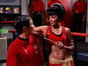 Uhura distracts Hikaru Sulu (mirror)