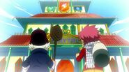 Young Natsu and Makarov at Fairy Tail