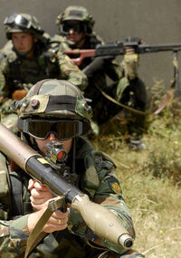 RPG soldier and squad.jpg