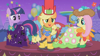 Applejack tries to hide her galoshes from view S1E14