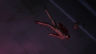 Ishida lying in a pool of blood