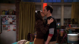 Amy kisses Sheldon