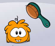 Orange puffle brush