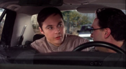 Sheldon in the back of Leonard's car