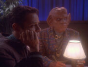 Bashir and Quark listen to Vic