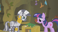 Twilight looks at the book that contains the remedy S1E09