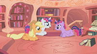 Twilight sitting with smiling Rarity and Applejack S1E8