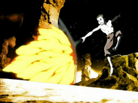 Aang deflects a fire blast with airbending