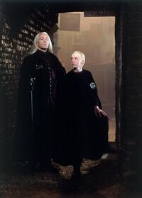 Lucius with his son in Knockturn Alley.