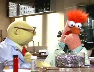 Bunsen offers Beaker some edible paper clips.