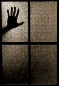 5645061-slightly-blurred-silhouette-of-a-hand-behind-a-window-or-glass-door-symbolizing-horror-or-fear.jpg